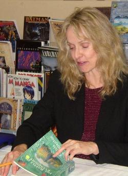 L'autrice, Cecilia Dart-Thorton, mentre concede un autografo