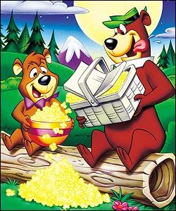 Yogi e Boo Boo con le mani nel cestino della merenda
