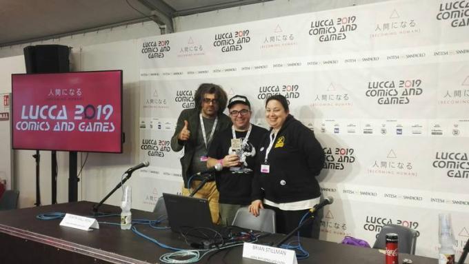 Brian Stillman premiato da Dimitri Galli Rohl al panel L'eleganza del Beholder a Lucca Comics & Games 2019.